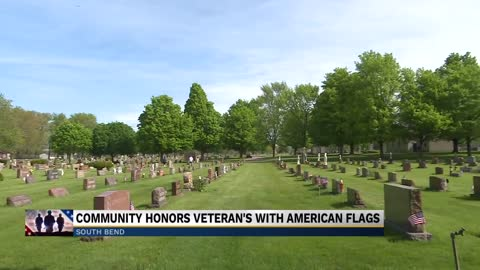 Community places flags at thousands of veterans' graves