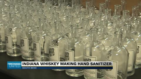 Local distillery bottling hand sanitizer for essential businesses