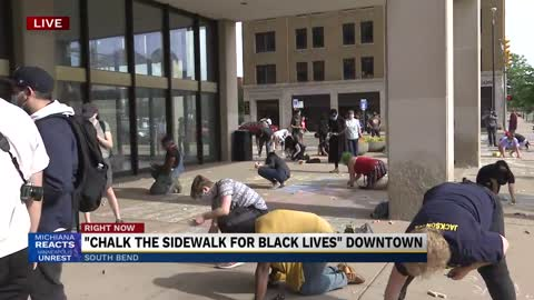 Names of victims of racial injustice written in chalk on South...
