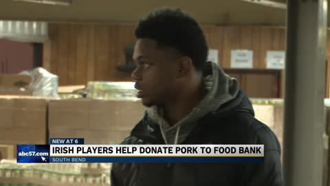 Notre Dame Football players help deliver food donation