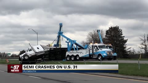 Semi-truck in Marshall County blown over by high winds