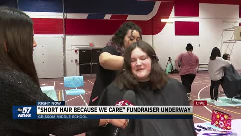 Students, teachers donating hair at Grissom Middle School for...
