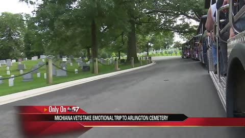 Vietnam vets stop at Arlington Cemetery before Memorial Wall