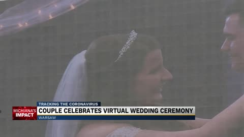 Warsaw couple hosts drive in wedding