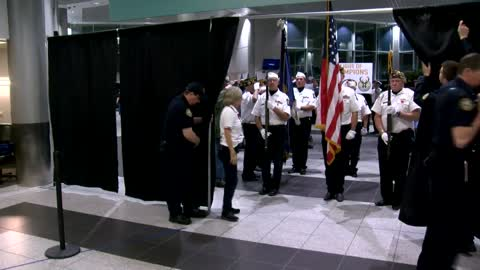 Flight of Champions Honor Flight returns to crowd full of people at Green Bay airport