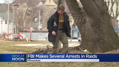 53 firearms, heroin, cocaine seized in Milwaukee FBI raids; 17...
