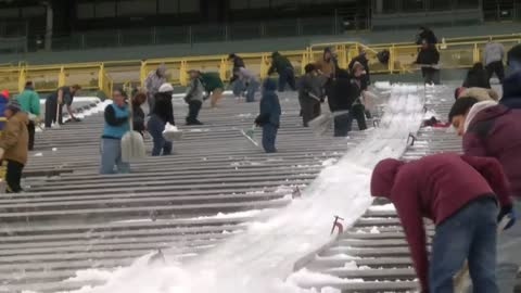 Fans are clearing the snow from Lambeau