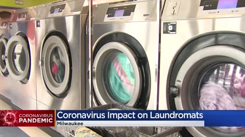 Some laundromats remain open as essential businesses with enforced...