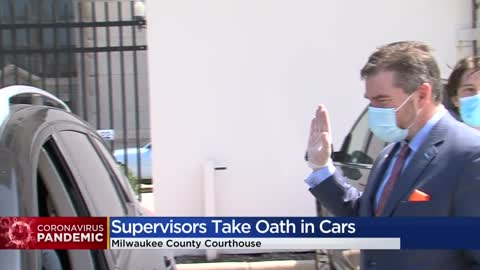 Newly-elected Milwaukee County board members take oaths of office curbside