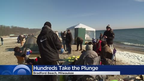 Hundreds take leap into Lake Michigan for annual 'Polar Bear Plunge'
