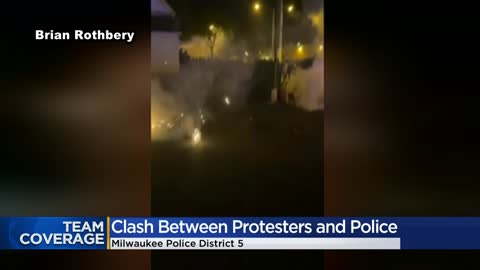 ' Protesters clash with officers at end of peaceful rally