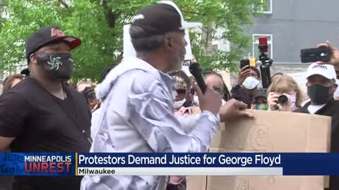 Protesters rallying in support of George Floyd block traffic...