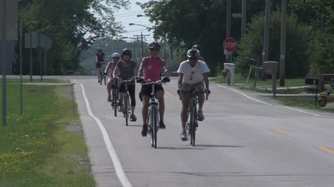 Group rides bikes along We Energies power plant to speak out against coal