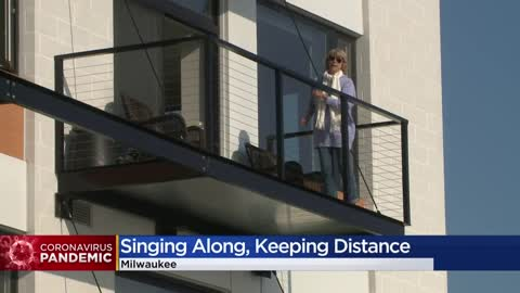 Third Ward residents practice social distancing while singing...