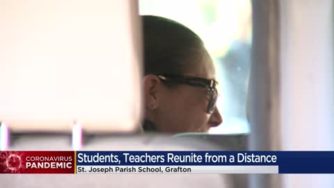 St. Joseph Parish School students and families thank teachers while staying safe