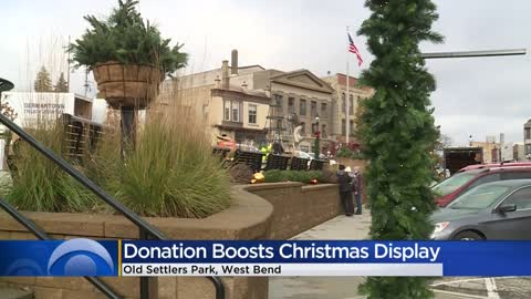 Volunteers decorate West Bend park for the holidays